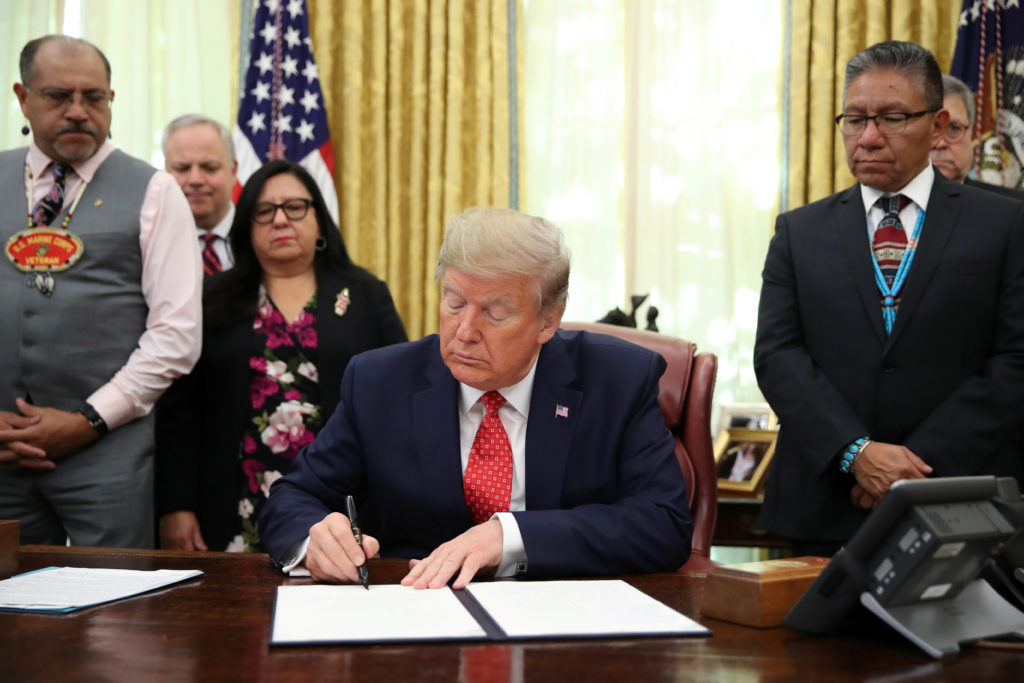 U.S. President Donald Trump signs an Executive Order to address the issue of missing and murdered Native Americans in the Oval Office at the White House in Washington, U.S. November 26, 2019. Photo by Jonathan Ernst/Reuters