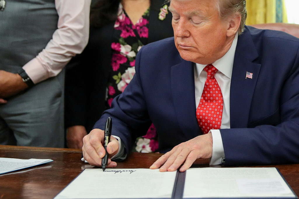 U.S. President Donald Trump signs an Executive Order to address the issue of missing and murdered Native Americans during a ceremony in the Oval Office at the White House in Washington, U.S. November 26, 2019. REUTERS/Jonathan Ernst