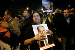 A supporter holds a picture of Lebanon's President Michel Aoun during a demonstration in Hazmiyeh, Lebanon on November 26, 2019. Photo by Andres Martinez Casares/Reuters