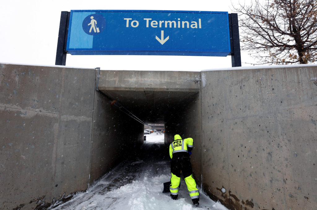 An airport worker shovels snow from a passage way after a pre-Thanksgiving holiday snowstorm caused more than 460 flight cancellations at Denver International Airport, Colorado, on November 26, 2019. Photo by Bob Strong/Reuters