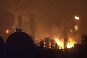 FILE PHOTO: Flames rise over a petrochemical plant after an explosion in a still image from video in Port Neches, Texas, U.S. November 27, 2019. 12NewsNow.com via Reuters