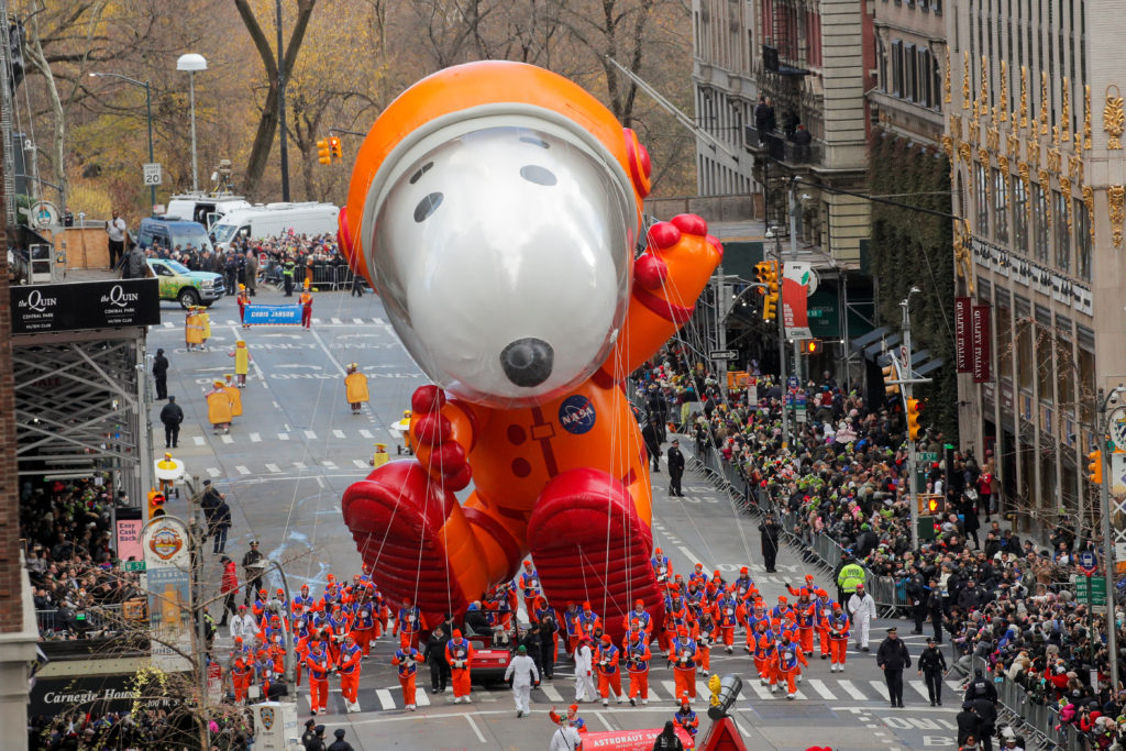 Astronaut Snoopy balloon hovers above the crowd during the 93rd Macy's Thanksgiving Day Parade in Manhattan,New York, U.S., November 28, 2019. Photo by Brendan Mcdermid/Reuters