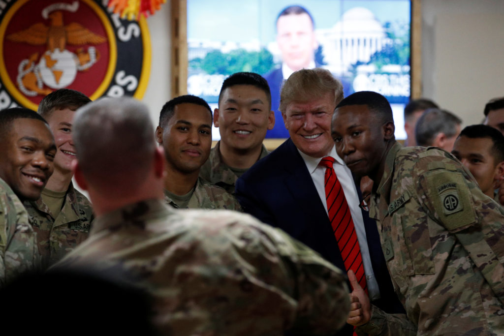 U.S. President Donald Trump takes a photo with U.S. troops during a surprise visit at Bagram Air Base in Afghanistan, November 28, 2019. Photo by Tom Brenner/Reuters