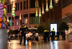 Police officers work near the site of a stabbing on a shopping stre…