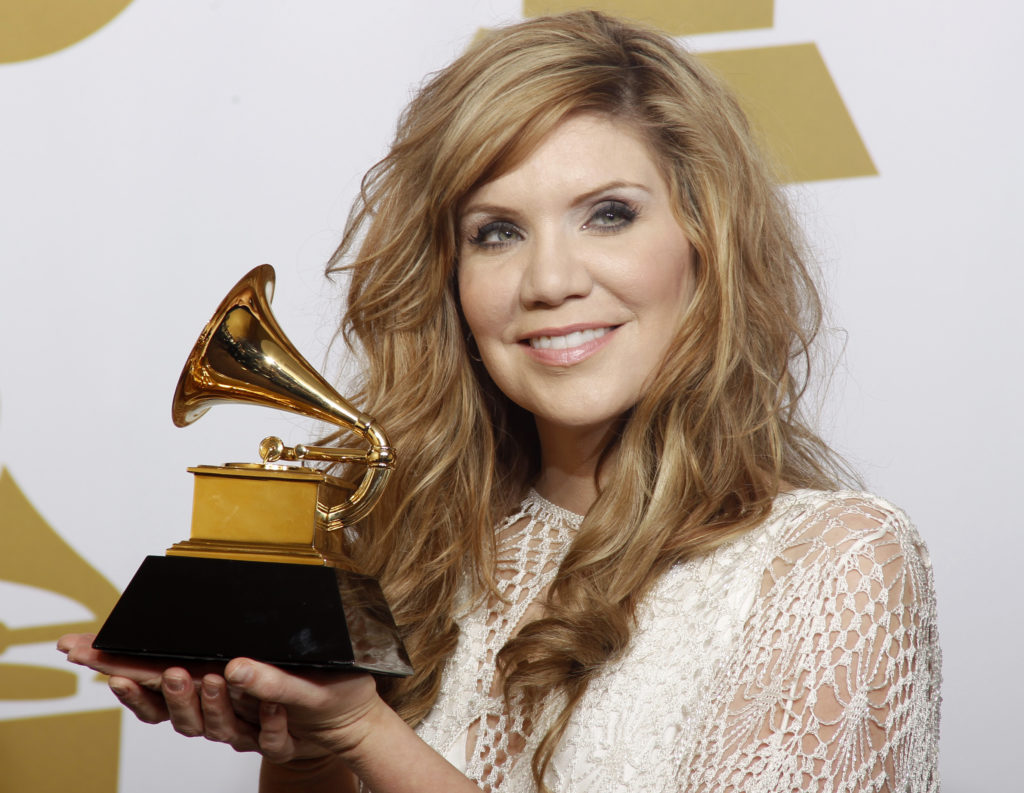 "Singer Alison Krauss holds her award for Best Bluegrass Album (""Paper Airplane"") at the 54th annual Grammy Awards in Los Angeles, California February 12, 2012. Krauss is one of four to receive the National Medal of Arts on Thursday. Photo by REUTERS/Lucy Nicholson"