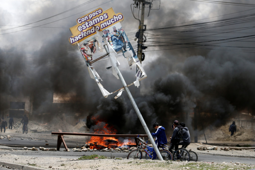 A barricade on fire is pictured as demonstrators take part in a protest in Senkata, El Alto, Bolivia November 19, 2019. Photo by REUTERS/David Mercado