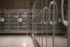 Emptied refrigerator shelves are pictured inside a darkened Target store in Novato, California on October 29, 2019. Pacific Gas & Electric Co. began shutting off electricity again on Wednesday to 375,000 people in Northern and central California to prevent power lines from sparking wildfires as the region faced a new bout of windy and warm weather. Photo by REUTERS/Stephen Lam
