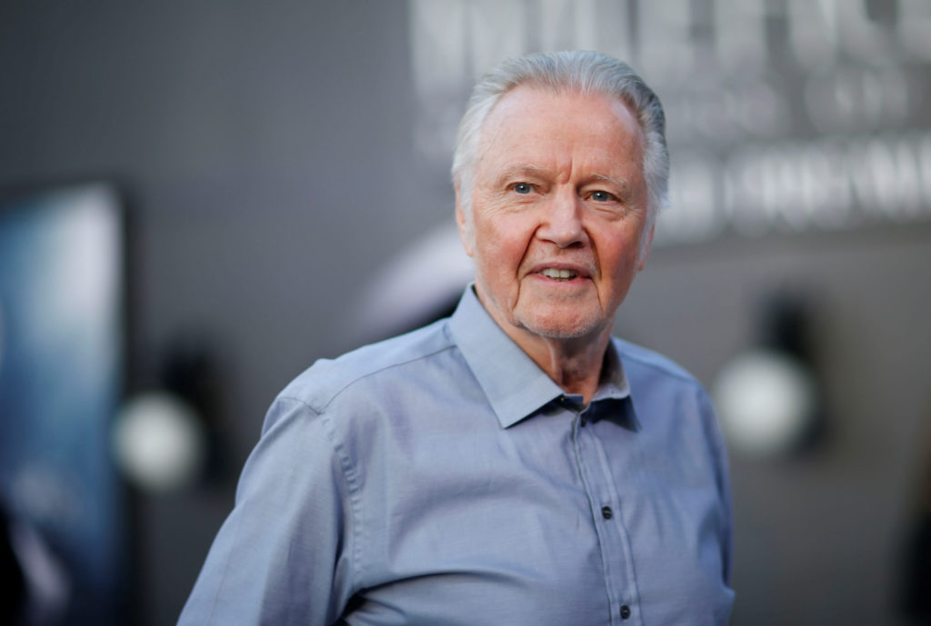 Angelina Jolie's father Jon Voight poses before the premiere of