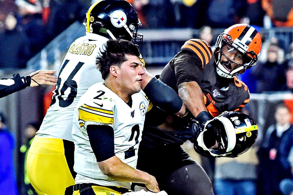 Cleveland Browns defensive end Myles Garrett (95) hits Pittsburgh Steelers quarterback Mason Rudolph (2) with his own helmet as offensive guard David DeCastro (66) tries to stop Garrett during the fourth quarter at FirstEnergy Stadium. Photo by Ken Blaze-USA TODAY Sports