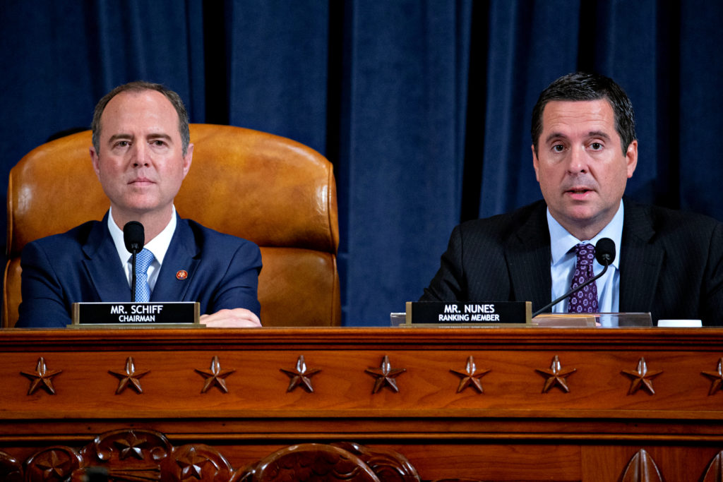 Representative Adam Schiff, a Democrat from California and chairman of House Intelligence Committee (left), and Devin Nunes, a Republican from California and ranking member during an impeachment inquiry hearing in Washington, D.C on Thursday, Nov. 21, 2019. Photo by Andrew Harrer/Pool via REUTERS