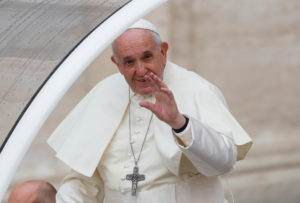 Pope Francis waves as he arrives for the weekly general audience at the Vatican, November 13, 2019. Photo by REUTERS/Remo Casilli