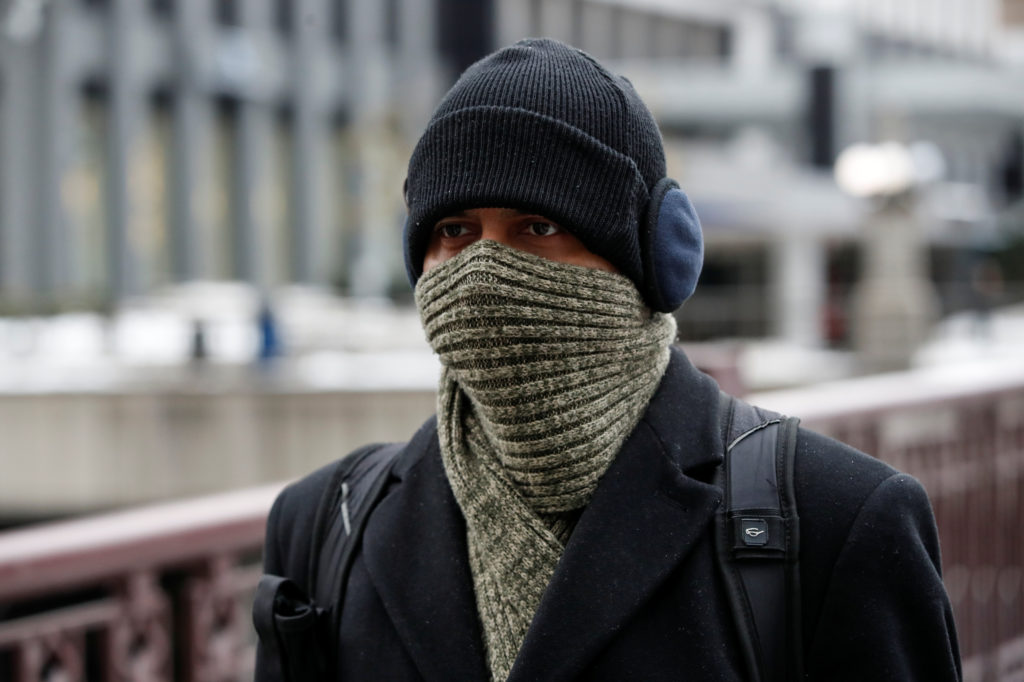 A man braves cold temperature as severe weather hits Chicago, Illinois, U.S. November 13, 2019. Photo by Kamil Krzaczynski/Reuters
