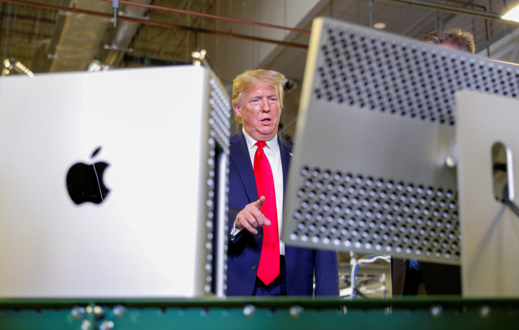 U.S. President Donald Trump views Apple products as he tours Apple's Mac Pro manufacturing plant in Austin, Texas, U.S., November 20, 2019. Photo by REUTERS/Tom Brenner