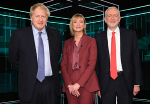 Conservative leader Boris Johnson, Julie Etchingham and Labour leader Jeremy Corbyn arrive in the studio prior to a televised debate between Johnson and Corbyn ahead of general election in London, Britain, November 19, 2019. Photo by Jonathan Hordle/ITV/Handout via REUTERS