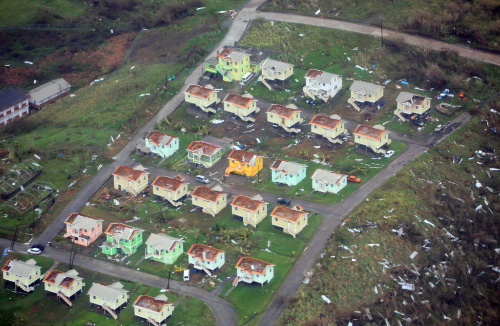 Damaged homes from Hurricane Maria are shown in this aerial photo over the island of Dominica, September 19, 2017.  After the storm, several neighboring countries used Free Movement Agreements to grant displaced Dominicans shelter. Courtesy Nigel R. Browne/Caribbean Emergency Management Agency/Regional Security System/Handout via REUTERS