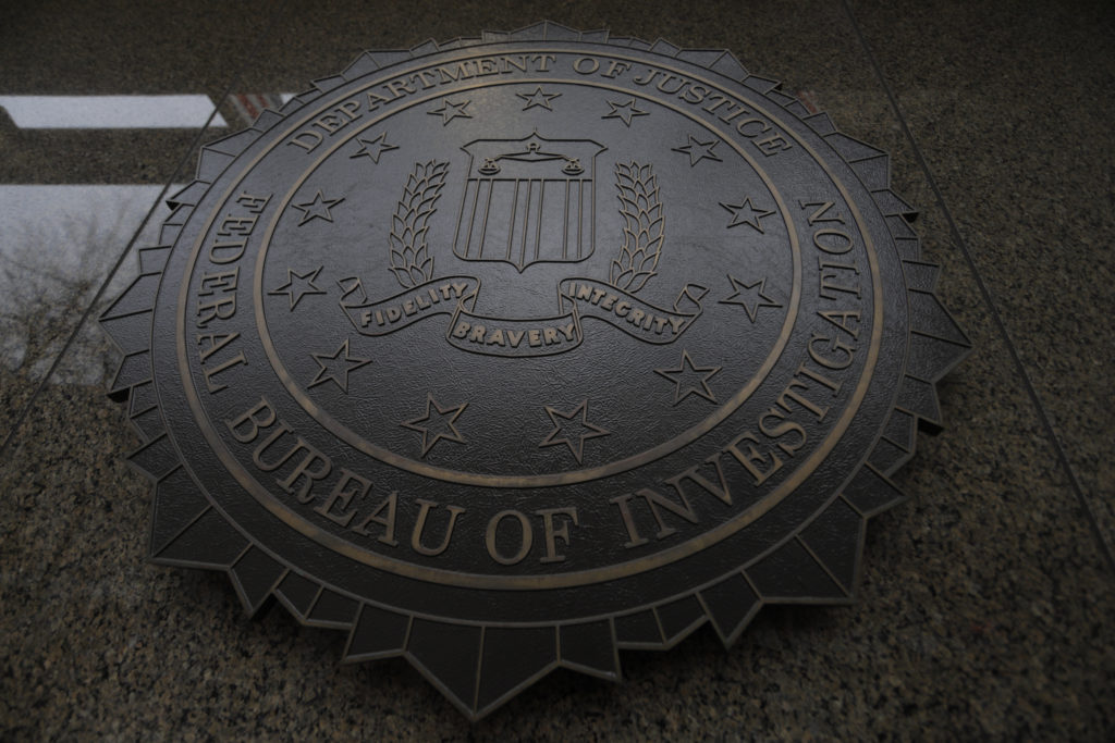 The FBI seal and motto are seen at of the J. Edgar Hoover Federal Bureau of Investigation (FBI) Building in Washington, U.S., February 1, 2018. Photo by Jim Bourg/Reuters