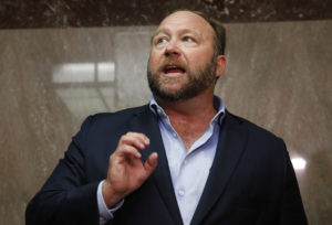 Alex Jones of Infowars talks to the media while visiting the U.S. Senate's Dirksen Senate office building as Twitter CEO Jack Dorsey testifies before a Senate Intelligence Committee hearing on Capitol Hill in Washington, U.S., September 5, 2018. Twitter permanently banned Jones and Infowars from its platforms September 6 over his actions seen on Twitter while visiting the building. Picture taken September 5, 2018. Photo by Jim Bourg/Reuters