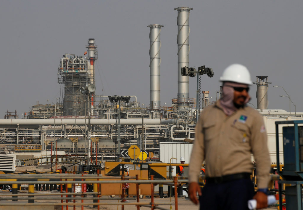 FILE PHOTO: An employee looks on at Saudi Aramco oil facility in Abqaiq, Saudi Arabia October 12, 2019. REUTERS/Maxim Shemetov/File Photo/File Photo