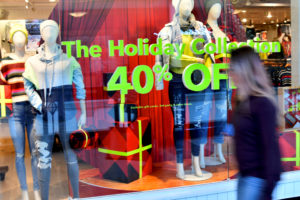 "A storefront sign states ""The Holiday Collection 40% OFF"" as pre-Thanksgiving and Christmas holiday shopping accelerates at the King of Prussia Mall in King of Prussia, Pennsylvania, U.S. November 22, 2019. Photo by Mark Makela/Reuters"