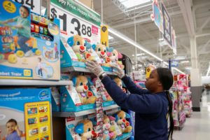 An employee puts up a toys display ahead of Black Friday at a Walmart store in Chicago, Illinois, U.S. November 27, 2019. Photo by Kamil Krzaczynski/Reuters
