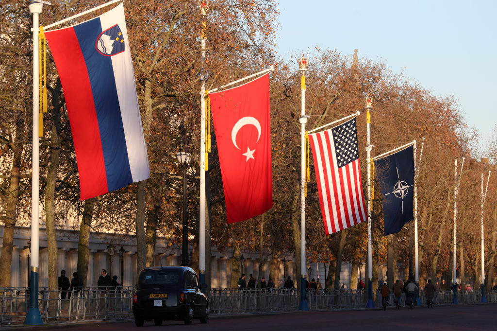 London taxi drives past NATO and members' flags ahead of Nato Summit in London, Britain. Photo by Yves Herman/Reuters