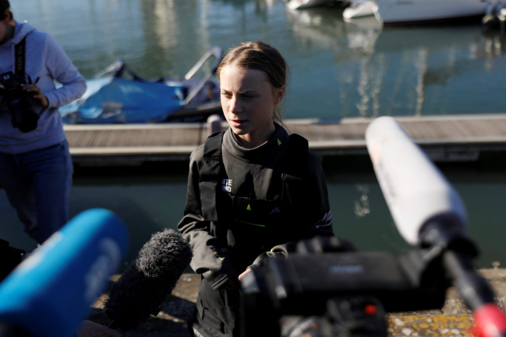 Climate change activist Greta Thunberg speaks upon her arrival at Santo Amaro port in Lisbon, Portugal December 3, 2019. P...