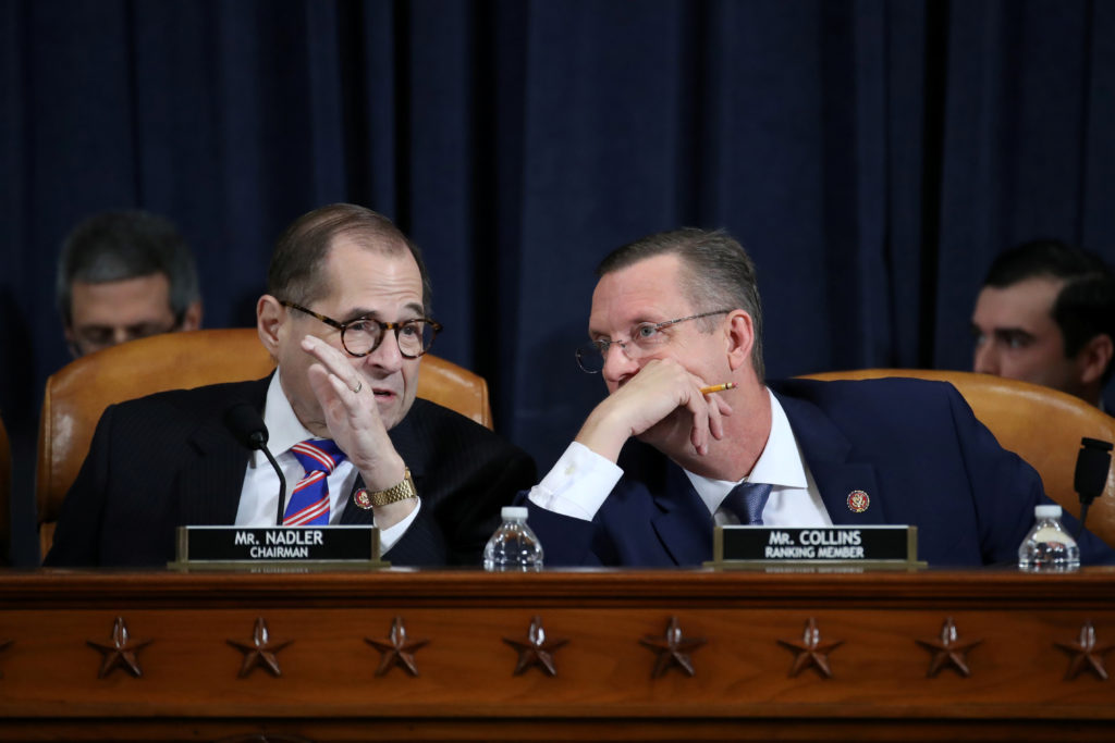 U.S. House Judiciary Committee Chairman Jerrold Nadler (D-NY) speaks with Republican ranking member Rep. Doug Collins (R-GA) during a House Judiciary Committee hearing on the impeachment Inquiry into U.S. President Donald Trump on Capitol Hill in Washington, U.S., December 4, 2019. Drew Angerer/Pool via REUTERS