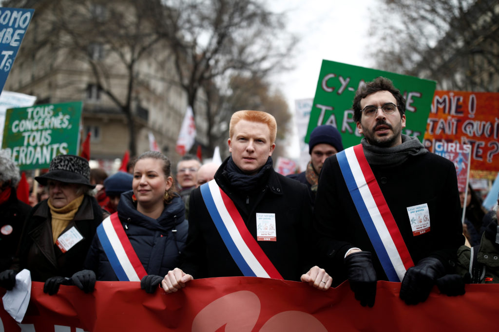Members of French parliament Mathilde Panot, Adrien Quatennens and Bastien Lachaud of La France Insoumise (France Unbowed) political party attend a demonstration against French government's pensions reform plans in Paris as part of a day of national strike and protests in France, December 5, 2019. Photo by Benoit Tessier/Reuters