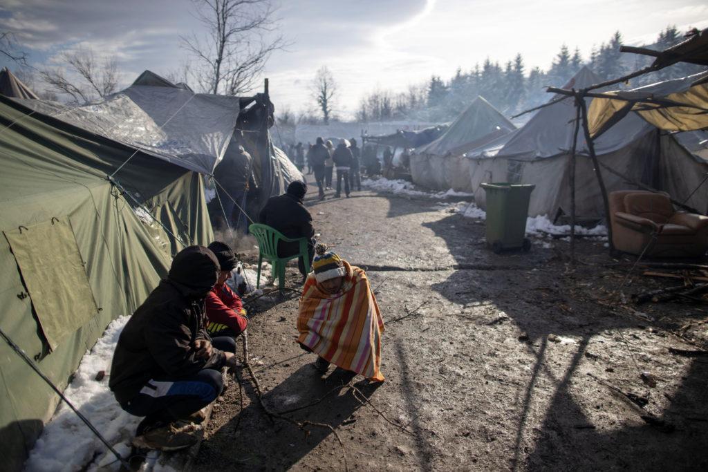 Migrants warm up at the migrant camp in Vucjak near Bihac, Bosnia and Herzegovina, December 6,2019. REUTERS/Antonio Bronic