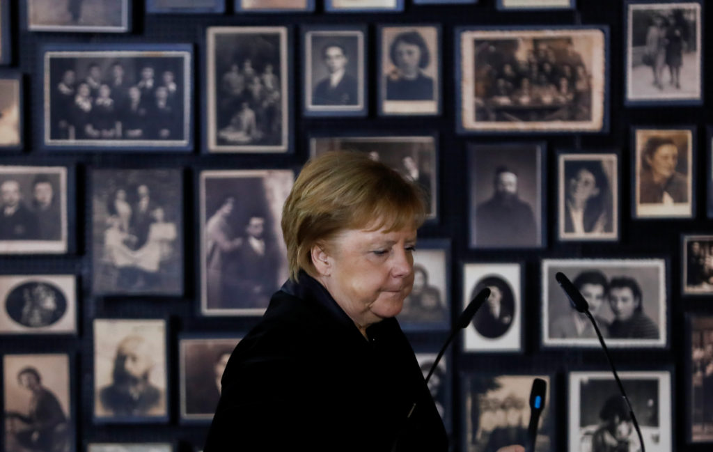 "German Chancellor Angela Merkel prepares to speak in the building of the so-called ""Sauna"" during her visit visit at the former Nazi German concentration and extermination camp Auschwitz-Birkenau near Oswiecim, Poland, December 6, 2019. Photo by Kacper Pempel/Reuters"