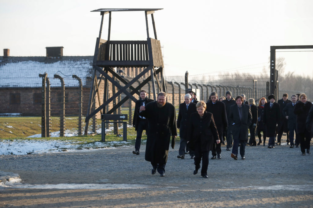 German Chancellor Angela Merkel and Poland's Prime Minister Mateusz Morawiecki visit the former Nazi German concentration and extermination camp Auschwitz II-Birkenau, near Oswiecim, Poland, December 6, 2019. Photo by Kacper Pempel/Reuters