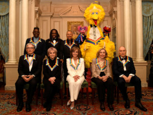 2019 Kennedy Center Honorees gather for a group photo (seated, L-R) conductor Michael Tilson Thomas, singer Linda Ronstadt, actress Sally Field, Sesame Street co-founders Joan Ganz Cooney and Dr. Lloyd Morrisette, (standing, L-R) Earth,Wind & Fire band members Philip Bailey, Verdine White and Ralph Johnson and Sesame Street characters Abby, Big Bird and Elmo, after a gala dinner at the U.S. State Department, in Washington, U.S., December 7, 2019. REUTERS/Mike Theiler