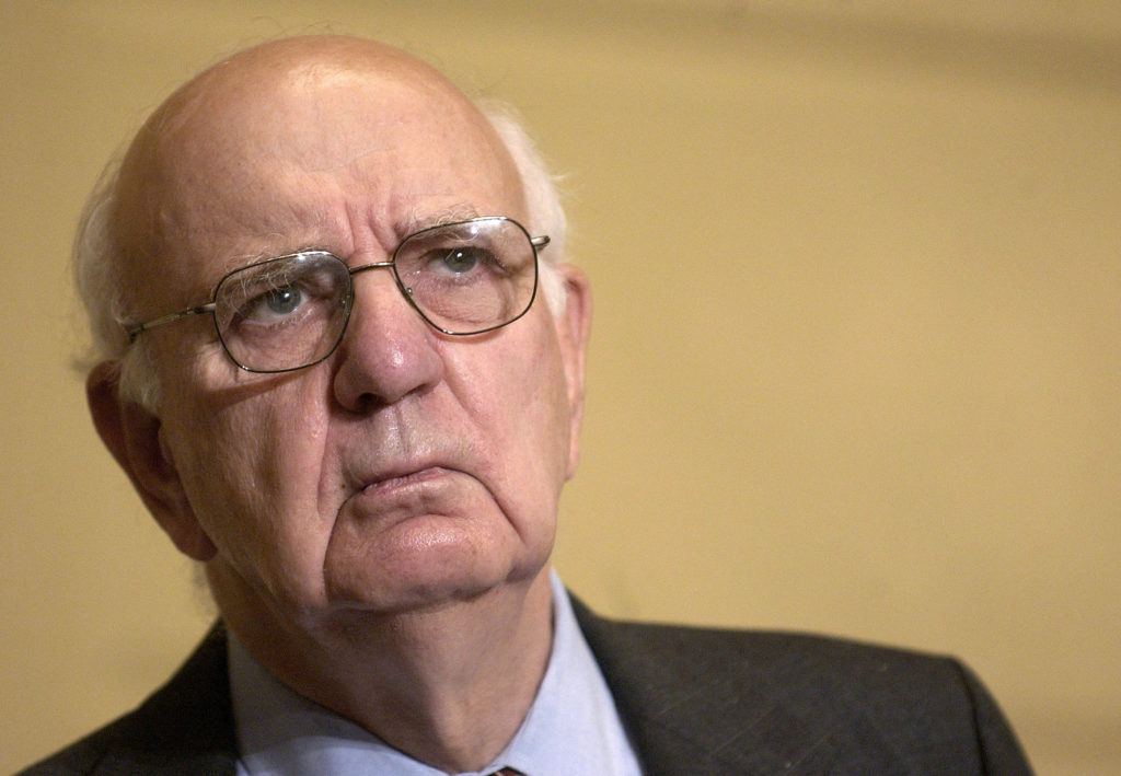FILE PHOTO: Paul Volcker, Chairman of the Independent Inquiry Committee, listens to journalists after addressing the [Secu...