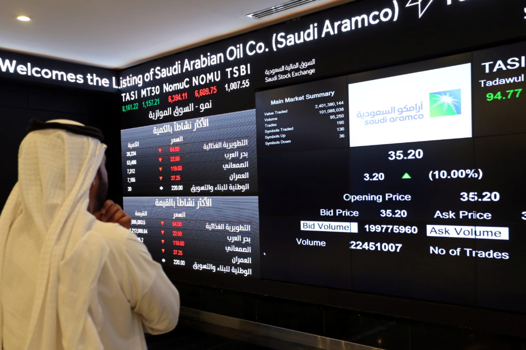 An investor monitors a screen displaying stock information at the Saudi Stock Exchange (Tadawul) following the debut of Saudi Aramco's initial public offering (IPO) on the Riyadh's stock market, in Riyadh, Saudi Arabia, December 11, 2019. Photo by Ahmed Yosri/Reuters