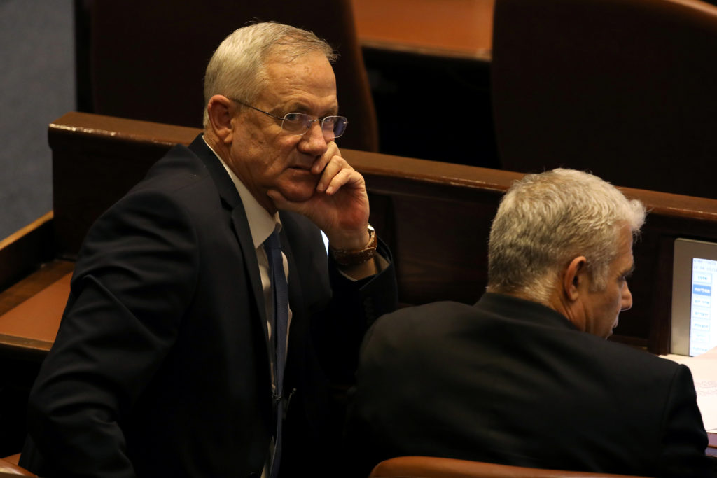 Benny Gantz, leader of Blue and White party, and Yair Lapid attend a parliamentary vote for its dissolution and approval of a date for a third national election in less than a year, at the Knesset, or Israel's parliament, in Jerusalem on December 11, 2019. Photo by Ammar Awad/Reuters