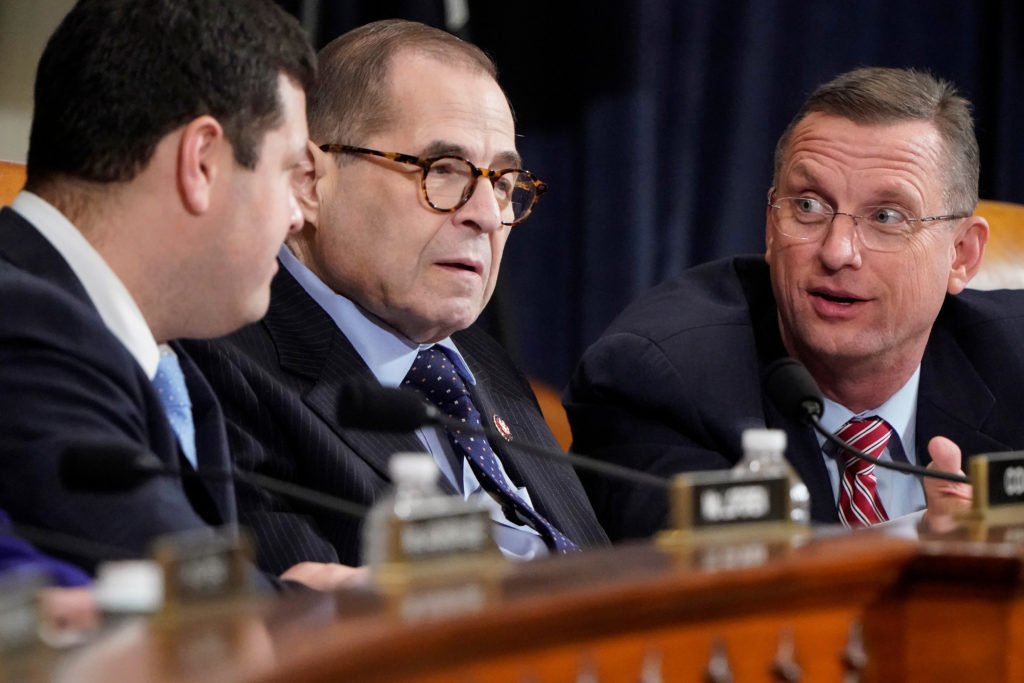 Rep. Doug Collins (R-GA) speaks with Chairman of the House Judiciary Committee Jerrold Nadler (R-NY) during opening statements as the House Judiciary Committee begins its markup of articles of impeachment against U.S. President Donald Trump on Capitol Hill in Washington, U.S., December 11, 2019. REUTERS/Joshua Roberts