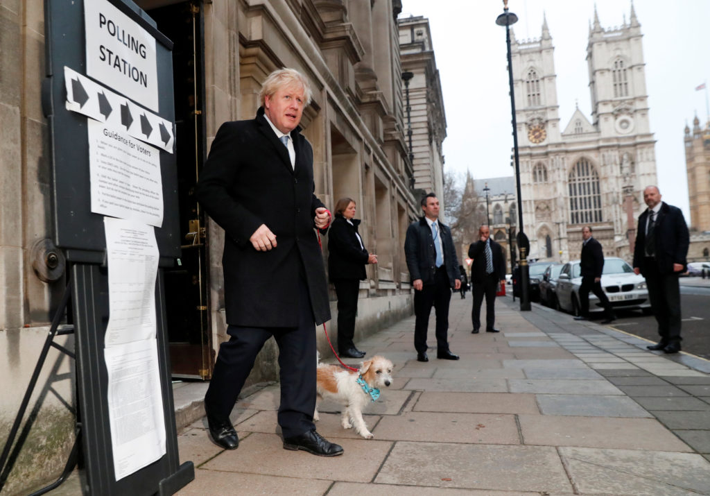 Britain's Prime Minister Boris Johnson leaves with dog Dilyn at a polling station, at the Methodist Central Hall, after voting in the general election in London, Britain, December 12, 2019. Photo by Thomas Mukoya/Reuters