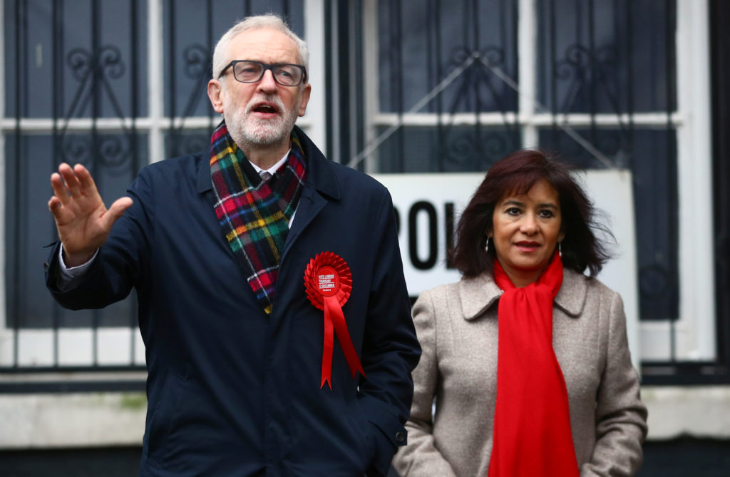 Britain's opposition Labour Party leader Jeremy Corbyn speaks next to his wife Laura Alvarez after voting the general election in London, Britain, December 12, 2019. Photo by Hannah McKay/Reuters