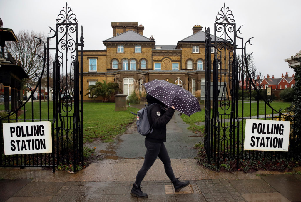 A woman walks past a polling station during the general election The Hove Museum and Art Gallery in Hove, Brighton and Hov...