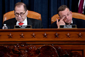 Representative Doug Collins, a Republican from Georgia and ranking member of the House Judiciary Committee, right, rubs his eye as Representative Jerry Nadler, a Democrat from New York and chairman of the House Judiciary Committee, sits during a House Judiciary Committee hearing in Washington, D.C., U.S., December 12, 2019. Andrew Harrer/Pool via REUTERS