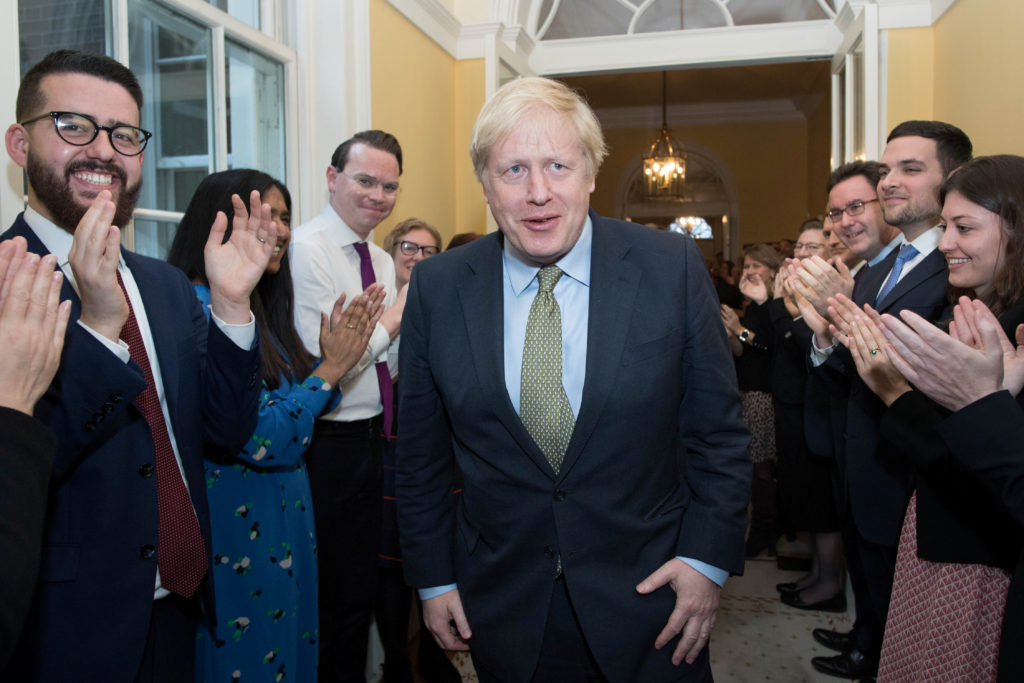 Britain's Prime Minister Boris Johnson is greeted by staff, arriving back at Downing Street, after meeting Queen Elizabeth and accepting her invitation to form a new government, in London, Britain December 13, 2019. Stefan Rousseau/Pool via Reuters