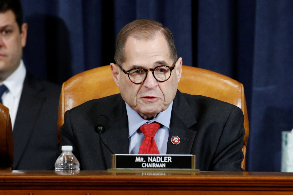House Judiciary Committee Charman Rep. Jerrold Nadler, D-N.Y., votes to approve the second article of impeachment against ...