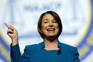 FILE PHOTO: Democratic U.S. Presidential candidate Senator Amy Klobuchar addresses the audience during the Presidential candidate forum at the annual convention of the National Association for the Advancement of Colored People (NAACP), in Detroit, Michigan, U.S., July 24, 2019. REUTERS/Rebecca Cook/File Photo