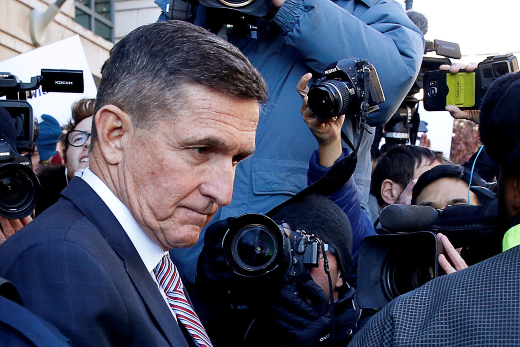Former U.S. national security adviser Michael Flynn passes by members of the media as he departs after his sentencing was delayed at U.S. District Court in Washington, on Dec. 18, 2018. Photo by REUTERS/Joshua Roberts