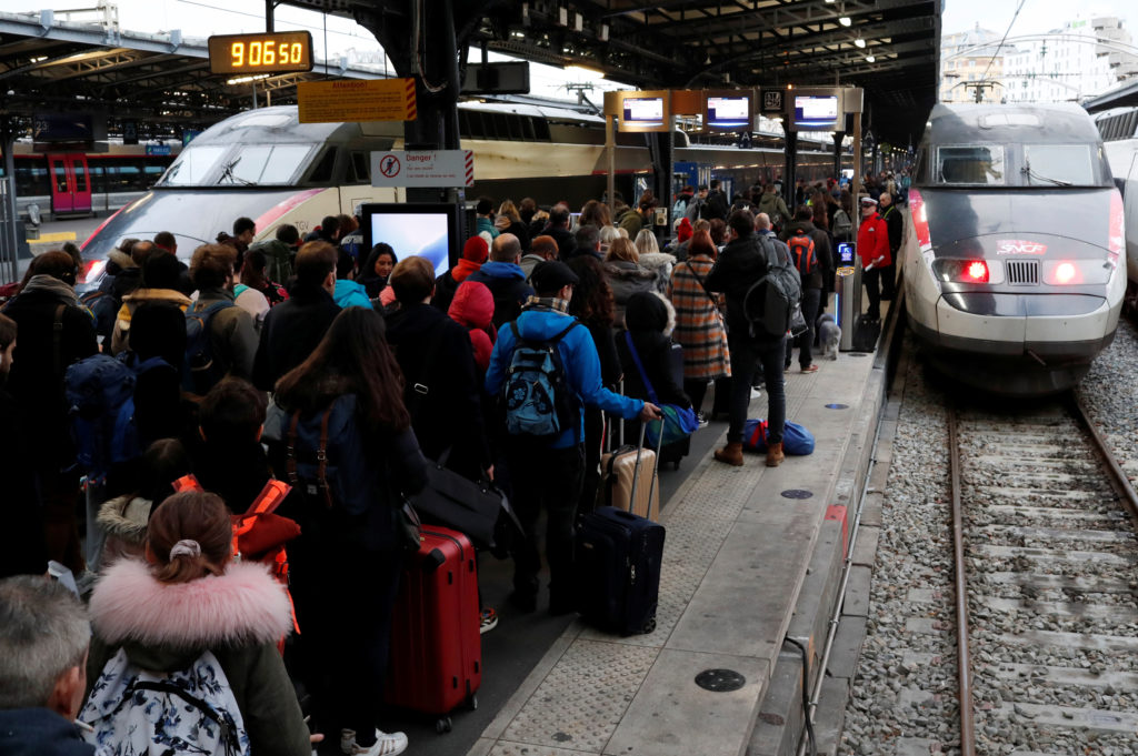 Commuters walk on a platform at Gare de l'Est train station during a strike by all unions of French SNCF and the Paris transport network (RATP) in Paris as French transportation workers' strike continues for a 19th day against pension reform plans in France, December 23, 2019. REUTERS/Gonzalo Fuentes