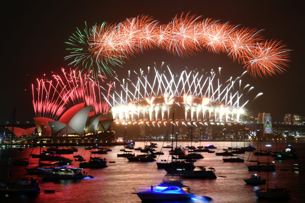 The midnight fireworks are seen from Mrs Macquarie's Chair during New Year's Eve celebrations in Sydney, Australia, December 31, 2019. AAP Image for City of Sydney/Mick Tsikas/via REUTERS