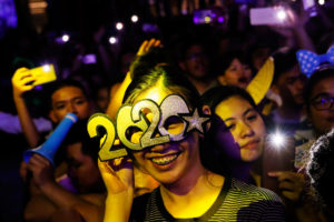 A reveller wears glasses shaped as the year 2020 during the New Year's Eve party in Quezon City, Metro Manila, Philippines December 31, 2019. Photo by Eloisa Lopez/Reuters