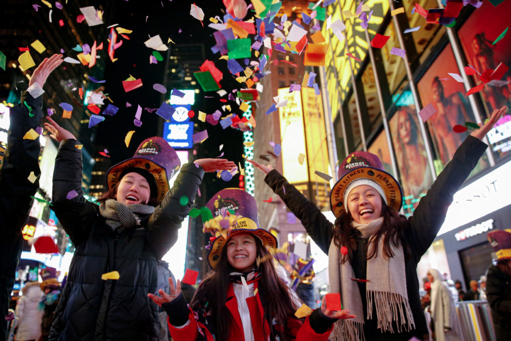 Revelers celebrate the New Year in Times Square in the Manhattan borough of New York City, U.S., January 1, 2020.  Photo by Amr Alfiky/Reuters