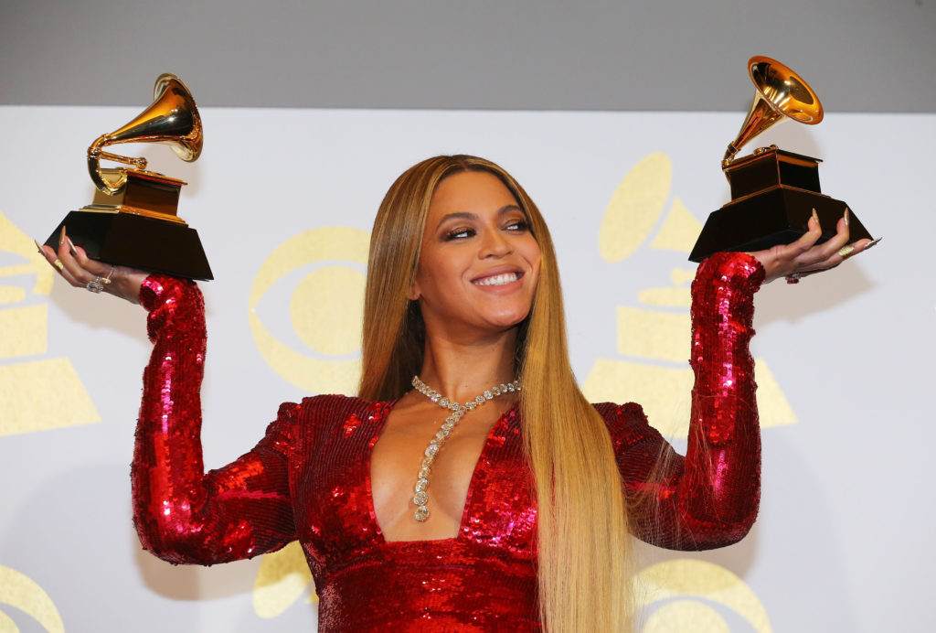 """Beyonce holds the awards she won for Best Urban Contemporary Album for """"Lemonade"""" and Best Music Video for """"Formation"""" at ..."""