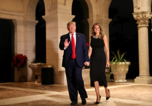 U.S. President Donald Trump and First Lady Melania Trump arrive to their Christmas Eve party at Trump's Mar-a-Lago resort in Palm Beach, Florida, U.S., December 24, 2019. Photo by REUTERS/Leah Millis